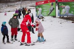 Ukraine, Kiev ski resort Protasov Yar January 25, 2015. The ski slope in the city center. Ski school for children. The instructor stock image