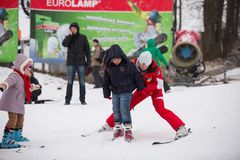 Ukraine, Kiev ski resort Protasov Yar January 25, 2015. The ski slope in the city center. Ski school for children. The instructor royalty free stock photo