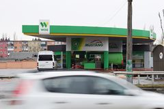 Ukraine, Kremenchug - March, 2019: Gas station WOG. Cars passing by in motion blur busy stock photos