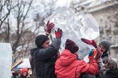Ukraine, Lviv - January 11, 2019: Workers install ice sculpture royalty free stock image