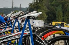 UKRAINE, LVIV - SEPTEMBER 2018: Sports bicycles in the parking area in the transfer area of the triathlon competition. Sports bicycles in the parking area in the stock photos