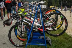 UKRAINE, LVIV - SEPTEMBER 2018: Sports bicycles in the parking area in the transfer area of the triathlon competition. Sports bicycles in the parking area in the stock image