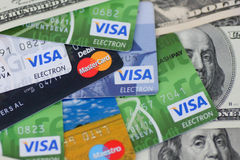 UKRAINE - on May 8: Heap of credit cards, Visas and MasterCard,. With US dollar accounts, Ukraine, on May 8, 2014 Royalty Free Stock Photography