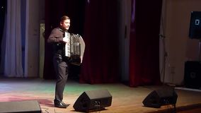 Ukraine is my native land. DNIPRO, UKRAINE - SEPTEMBER 23, 2017: Famous accordionist Vladimir Zuban performs Ukrainian folk songs at the Philharmonic stock footage