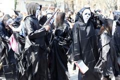 UKRAINE, ODESSA - April 1, 2019: a celebration of humor and laughter, humor, young people in costumes from the movie Scream. Fool stock images
