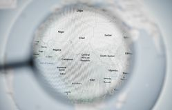 UKRAINE, ODESSA - APRIL 25, 2019:  Google maps planet earth globe through magnifying glass. royalty free stock images