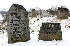 11.23.2014. Ukraine. An old Jewish cemetery. Ancient tombstones with inscriptions in Yiddish sticking out of the earth. 11.23.2014. Ukraine. An old Jewish royalty free stock photography