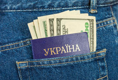 Ukraine passport and dollar bills Stock Photography