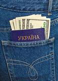 Ukraine passport and dollar bills in the jeans pocket Royalty Free Stock Photography