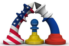 Ukraine - a pawn in the geopolitical game. Concept. Chess pieces - kings in the colors of flags of Russia and the US are bent to each other, and between them a Stock Photo