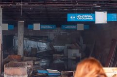 Blue signs with white title and broken furniture in destroyed shop in Pripyt, Chernobyl zone of alien stock image
