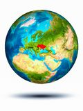 Ukraine on Earth with white background. Ukraine in red on model of planet Earth hovering in space. 3D illustration isolated on white background. Elements of this royalty free stock photos