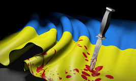 Ukraine and Russia crisis represented by a bloody knife in the Ukrainian flag Royalty Free Stock Photo