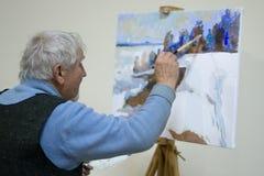 Ukraine,Shostka, Art Center, Mira street -December 15, 2017: The artist paints winter landscape with oil paints. Ukraine,Shostka, Art Center, Mira street Stock Photo