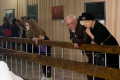 Ukraine,Shostka, Art Center, Mira street -December 15, 2017: Mature couple and girl teenager at an art exhibition. Ukraine,Shostka, Art Center, Mira street Royalty Free Stock Image