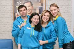 Ukraine, Shostka -March 8, 2019: Happy smiling team of sales assistants in uniform. Ukraine, Shostka -March 8, 2019: Happy smiling young team of sales assistants stock photography