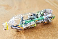 Ukraine, Shostka -March 20, 2019: Used batteries in a plastic bottle, the topic of sorting garbage royalty free stock image