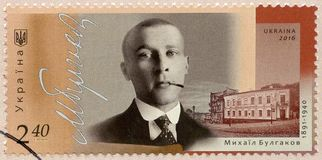 UKRAINE - 2016: shows portrait of Mikhail Afanasyevich Bulgakov 1891-1940, Russian writer and playwright. UKRAINE - CIRCA 2016: A stamp printed in Ukraine shows Stock Images