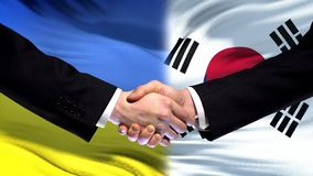 Ukraine and South Korea handshake, international friendship, flag background. Stock photo stock images