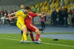 Ukraine and Spain national football teams are playing against each other Stock Photos