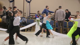 UKRAINE, TERNOPIL, MARCH 12, 2016: Children couples - dancing waltz on the contest Grande Cup. UKRAINE, TERNOPIL, MARCH 12, 2016: Children couples- dancing waltz stock video