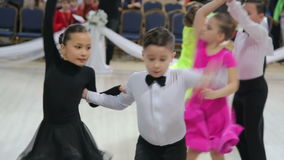 UKRAINE, TERNOPIL, MARCH 12, 2016: Little couple dancing Rock and roll. Children dance contest Grande Cup stock video footage