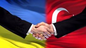 Ukraine and Turkey handshake, international friendship relations flag background. Stock photo stock photos