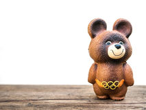 UKRAINE, UKRAINE - JULY 26, 2017: Vintage Russian Olympic bear. UKRAINE, UKRAINE - JULY 26, 2017: Vintage Russian Olympic bear toy with white copy space Stock Photo