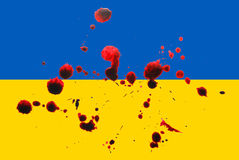 Ukraine war. Ukraine flag with blood stains, concept image suggesting the ukrainian war in eastern europe Royalty Free Stock Images