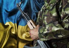 Ukraine waving flag with soldier Stock Image