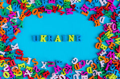 UKRAINE - word composed of small colored letters on blue background fith frame of many little letter. 2017 year.  Stock Images