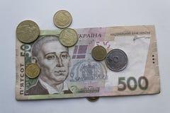 Ukrainer Hryvnia Ukrainisches Geld Banknote mit Münzen nahaufnahme Stockfotos