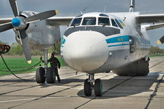 Ukrainian Air Force An-26. Vasilkov, Ukraine - April 24, 2012: Ukraine Air Force Antonov An-26 cargo plane is preparing to start the engines with the starter Stock Photography