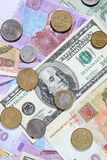 Ukrainian and American money is a background Stock Photos
