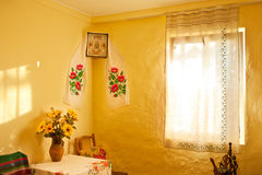 Ukrainian ancient design interior. Ukrainian ancient design interior with sunflowers and morning sun light from window Stock Image