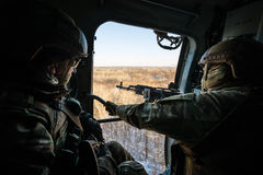 Ukrainian army helicopter patrols the area of of the antiterrori. DONETSK REGION, UKRAINE - Dec 05, 2016: Ukrainian army helicopter during a combat mission in Stock Photos