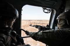 Ukrainian army helicopter patrols the area of of the antiterrori. DONETSK REGION, UKRAINE - Dec 05, 2016: Soldiers of Armed Forces of Ukraine with guns on board Stock Photo