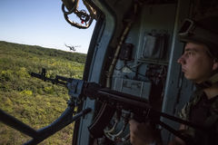 Ukrainian army helicopter patrols area of antiterrorist operatio. DONETSK REG, UKRAINE - Aug 02, 2015: Ukrainian army helicopter patrols the area of the Stock Photos