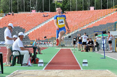 Ukrainian athlete jumps in length Royalty Free Stock Photo