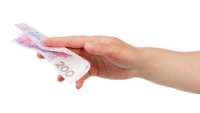 Ukrainian banknote denomination of 200 hryvnia in female hand isolated. Ukrainian banknote denomination of 200 hryvnia in a female hand isolated on white royalty free stock image