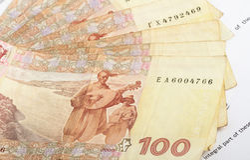Ukrainian banknotes. Many ukrainian banknotes of hundreds laid out on document Stock Photography