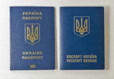 Ukrainian biometric and common passports against white background Stock Photo