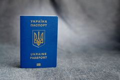 Ukrainian biometric passport on a gray background. With space stock photography