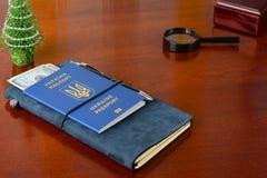 Ukrainian biometric passport. Preparing for the christmas trip.  Royalty Free Stock Images