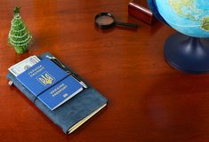 Ukrainian biometric passport. Preparing for the christmas trip.  Royalty Free Stock Photography