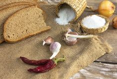 Ukrainian black bread with spices, onions, garlic and salt. Stock Photography