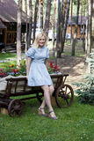 Ukrainian blonde girl sitting on a cart Royalty Free Stock Photo