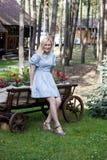 Ukrainian blonde girl sitting on a cart Royalty Free Stock Photo