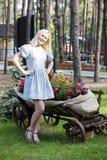Ukrainian blonde girl sitting on a cart Royalty Free Stock Photos