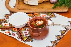 Ukrainian borsch and a bowl of sour cream Royalty Free Stock Photography